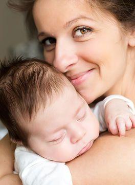 mother-cuddling-baby_700x700_shutterstock_131776571